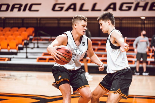 Oklahoma State walk-on Carson Sager, left, practices on Wednesday.  Sager received word he made the team from his brother, Christien, who also played for OSU. [Courtney Bay/OSU Athletics]