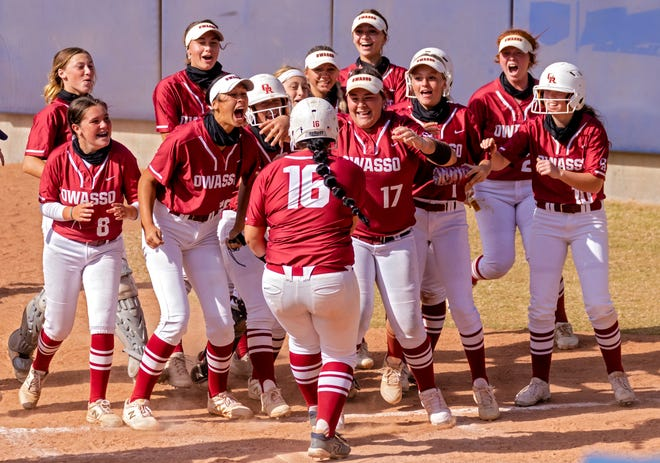 Owasso celebrates as Lilly Shaw (16) crosses home plate for a score against Edmond Memorial during the high school state championship fast pitch softball semifinals at ASA Hall of Fame Stadium in Oklahoma City, Okla. on Friday, Oct. 16, 2020. [Chris Landsberger/The Oklahoman]