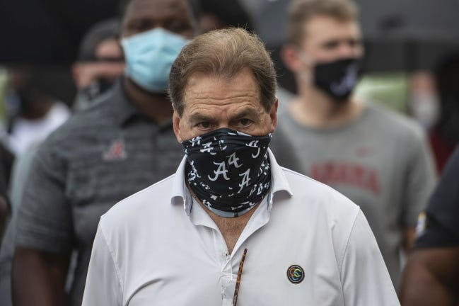 FILE - In this Aug. 31, 2020, file photo, Alabama head football coach Nick Saban leads his team as they march on campus, supporting the Black Lives Matter movement, in Tuscaloosa, Ala. The mid-week news that Alabama coach Nick Saban tested positive for COVID-19 added a challenging backdrop for the seasonþÄôs first Top 5 matchup. Saban figures to be communicating his marching orders and input from home while offensive coordinator Steve Sarkisian is manning the show within the football building. (AP Photo/Vasha Hunt, File)