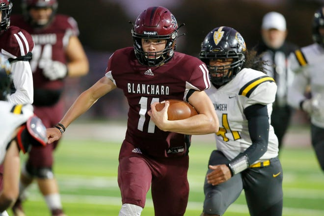 Blanchard's Colby Langford carries the ball during a high school football game between Blanchard and Tecumseh in Blanchard, Okla., Thursday, Oct. 15, 2020. [Bryan Terry/The Oklahoman]