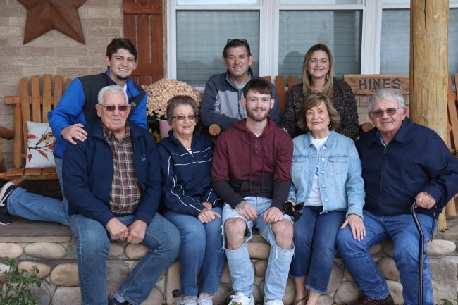 Fort Cobb-Broxton basketball coach Scott Hines, back middle, is pictured with his family after returning home Thursday from a three-month battle with COVID-19 in Oklahoma City. [Photo provided]
