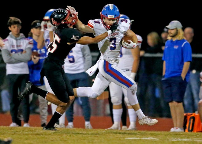 OCS' Collin Matteson stiff arms Luther's Zac Parsons during the high school football game between Luther and Oklahoma Christian Schools at Luther High School in Luther, Oka., Friday, Oct. 16, 2020. The play was called back because of penalty. Photo by Sarah Phipps, The Oklahoman