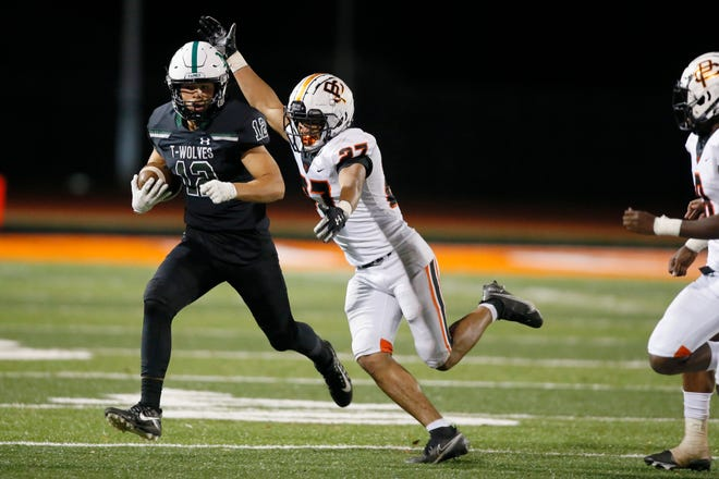 Norman North's Luke Switzer tries to get past Putnam City's Jaden Elam during Friday's game in Norman. [Bryan Terry/The Oklahoman]