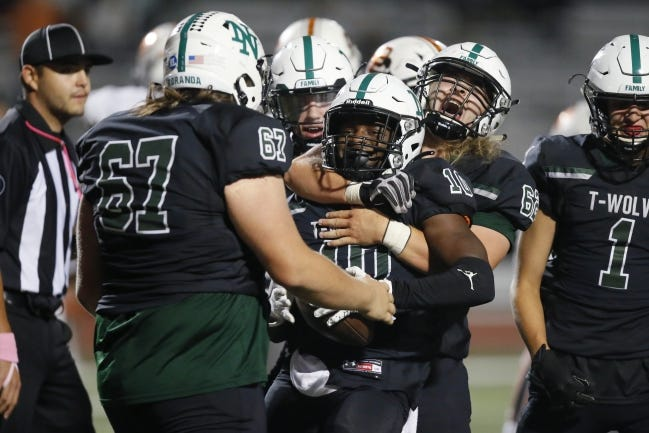 Norman North's Gavin Anderson, left, and Jackson Lancaster celebrate after Anderson recovered a fumble during a high school football game between Norman North and Putnam City in Norman, Okla., Friday, Oct. 16, 2020. [Bryan Terry/The Oklahoman]