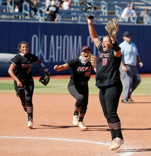 Tuttle's Cami Cobb, right, celebrates after wining the Class 4A state softball championship game between Tuttle and Lone Grove at USA Softball Hall of Fame Stadium in Oklahoma City, Saturday, Oct. 17, 2020. [Bryan Terry/The Oklahoman]