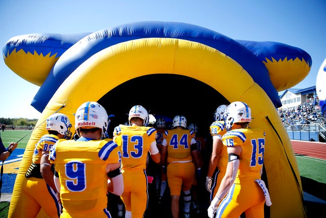 Piedmont prepares to run onto the field during the high school football game between Piedmont and Carl Albert at Piedmont High School in Piedmont, Oka., Saturday, Oct. 17, 2020. Photo by Sarah Phipps, The Oklahoman