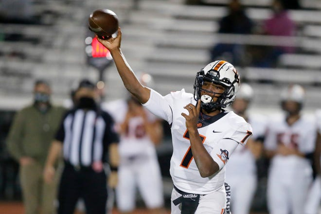 Putnam City's Marcellous Hawkins throws a pass during a high school football game between Norman North and Putnam City in Norman, Okla., Friday, Oct. 16, 2020. [Bryan Terry/The Oklahoman]