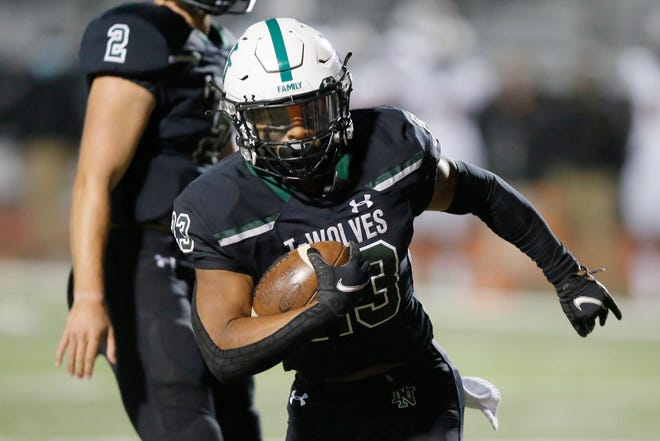 Norman North's Gabe Trevillison carries the ball during a high school football game between Norman North and Putnam City in Norman, Okla., Friday, Oct. 16, 2020. [Bryan Terry/The Oklahoman]