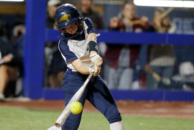Southmoore's Riley Sharp drives in the game-winning run during the Class 6A state softball championship game between Southmoore and Owasso at USA Softball Hall of Fame Stadium in Oklahoma City, Saturday, Oct. 17, 2020. [Bryan Terry/The Oklahoman]
