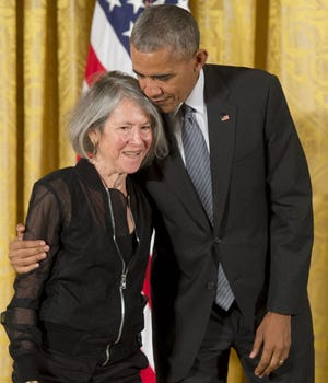 US President Barack Obama presents poet Louise Glück with the 2015 National Humanities Medal during a Sept. 22, 2016, ceremony in the East Room of the White House in Washington, DC. [Photo by SAUL LOEB/AFP via Getty Images/TNS]