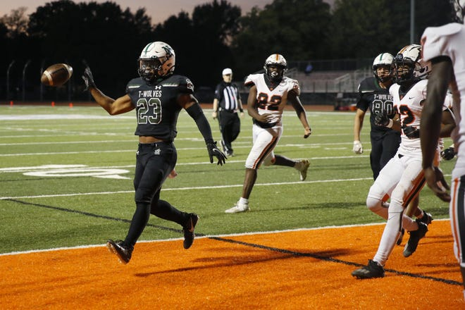 Norman North's Gabe Trevillison scores a touchdown against Putnam City in Norman on Friday night. [BRYAN TERRY/THE OKLAHOMAN]