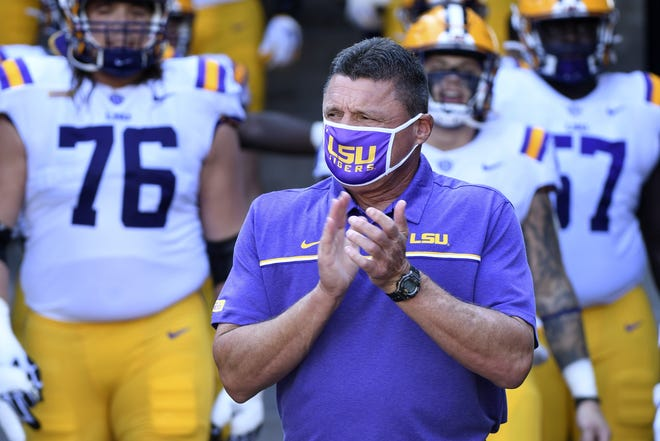 LSU coach Ed Orgeron accrued more than $1.77 million in bonuses last year, which means he made more in bonus payments alone than at least 50 FBS coaches made in total compensation during the same time period. [AP Photo/L.G. Patterson]