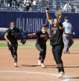 Tuttle's Cami Cobb, right, celebrates after winning the Class 4A state softball championship against Lone Grove on Saturday in Oklahoma City.