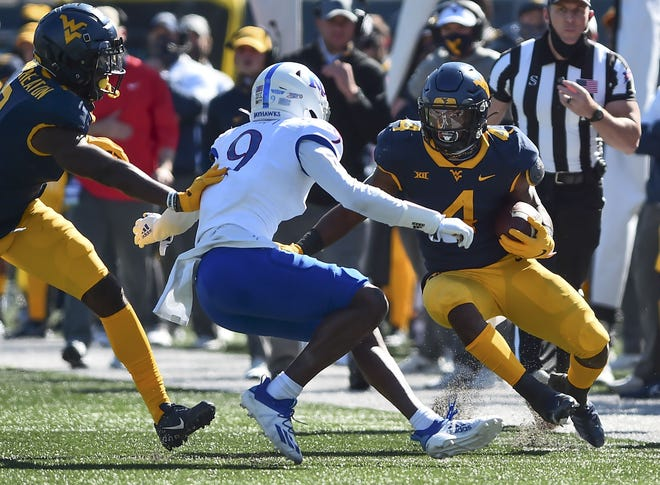West Virginia running back Leddie Brown (4) rushes the ball against Kansas. [(William Wotring/The Dominion-Post via AP]