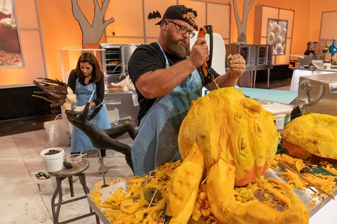 """Team Mummies Rejects Pumpkin Carver Daniel Miller, who hails from Wilson, Oklahoma, sculpts a giant octopus head during Episode 4 of """"Halloween Wars"""" Season 10. [Food Network photo]"""
