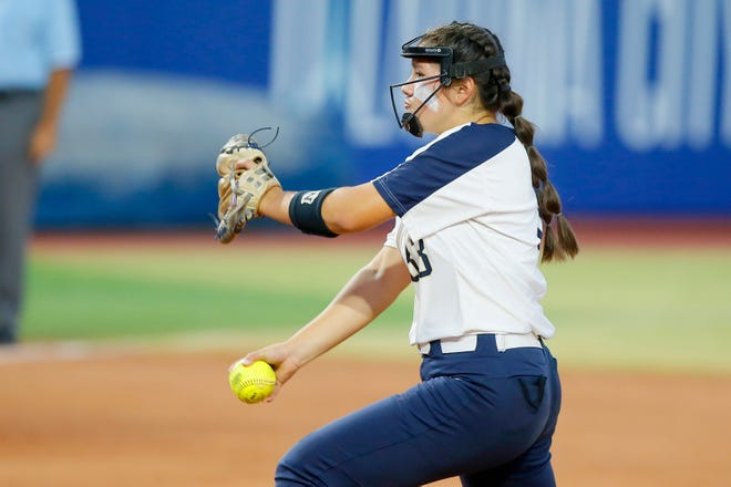 Southmoore's Brinly Maples pitches during the Class 6A state softball championship game between Southmoore and Owasso at USA Softball Hall of Fame Stadium in Oklahoma City, Saturday, Oct. 17, 2020. [Bryan Terry/The Oklahoman]