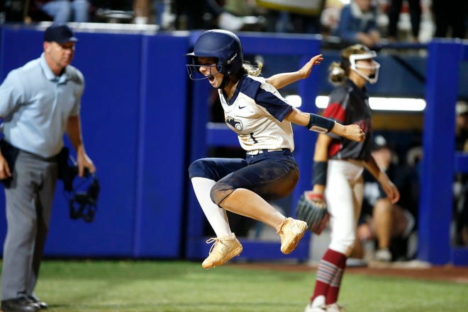Southmoore's Abi Jones celebrates after scoring the game-winning run during the Class 6A state softball championship game between Southmoore and Owasso at USA Softball Hall of Fame Stadium in Oklahoma City, Saturday, Oct. 17, 2020. [Bryan Terry/The Oklahoman]