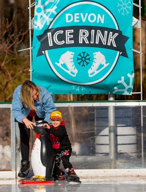 Emma Petry helps her son Troy, 4, as they try to keep their footing on the ice while skating at the Devon Ice Rink in Oklahoma City, Okla. on Wednesday, Jan. 1, 2020. [Chris Landsberger/The Oklahoman Archives]