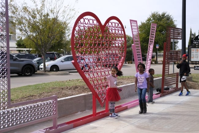 """""""Key To My Heart,"""" an art project by Zonly Looman, was installed last week in the Farmers Market area of downtown Edmond. The piece is meant to echo the tradition of lovers adding locks to the famous Love Lock Bridge in Paris. Couple are encouraged to add their locks to symbolically display their everlasting love and connection. [Doug Hoke/The Oklahoman]"""
