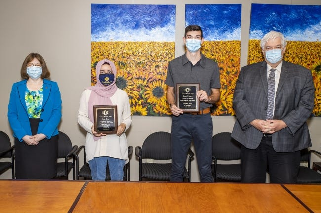 University of Central Oklahoma students Alaa Baha, Jacob Friesen and Zoie Hing recently received UCO Scholastic Awards in recognition of their academic work during the 2019-20 academic year. Pictured, from left, are Charlotte Simmons, co-interim vice president for Academic Affairs; Baha; Friesen; and Gary Steward Jr., co-interim vice president for Academic Affairs. [PHOTO PROVIDED]