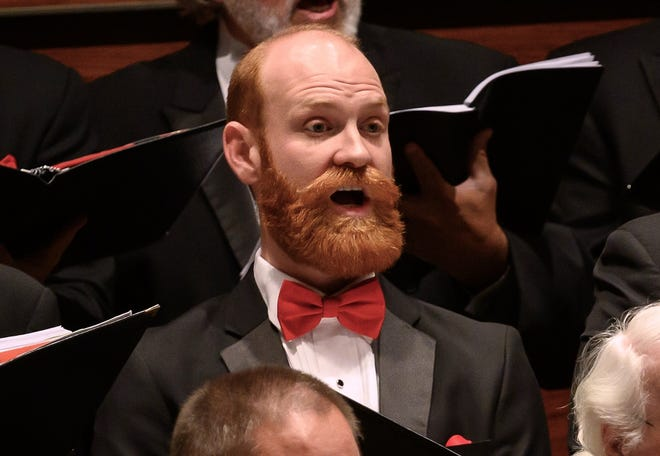 Chad Taylor sings bass with Canterbury Voices. [Performing Arts Photos]