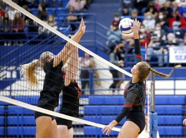 Mustang's Ruby Kelley goes up to spike the ball against Tulsa Bishop Kelley during Tuesday's Class 6A state volleyball championship in five sets in Choctaw. [Sarah Phipps/The Oklahoman]