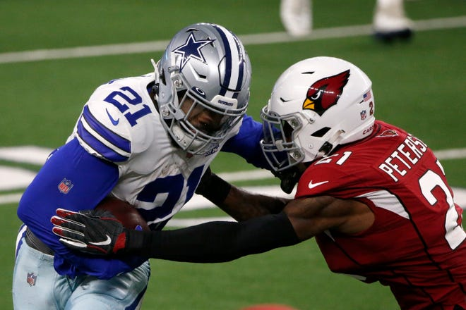 Dallas Cowboys' Ezekiel Elliott (21) gains a first down running the ball against Arizona Cardinals' Patrick Peterson, right, in the second half of an NFL football game in Arlington, Texas, Monday, Oct. 19, 2020. (AP Photo/Michael Ainsworth)