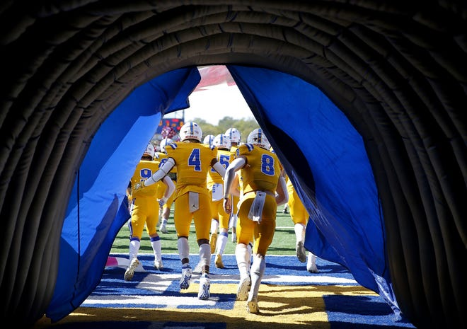 Piedmont's Decata Warrior (4) and Cade Hendren (8) run onto the field before a game against Carl Albert last Saturday. [Sarah Phipps/The Oklahoman]