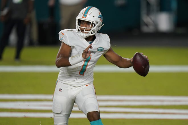 Miami Dolphins quarterback Tua Tagovailoa (1) looks to pass during the second half of an NFL football game against the New York Jets, Sunday, in Miami Gardens, Fla. A source says Tagovailoa will replace Ryan Fitzpatrick as Miami's starting quarterback. [AP Photo/Lynne Sladky]