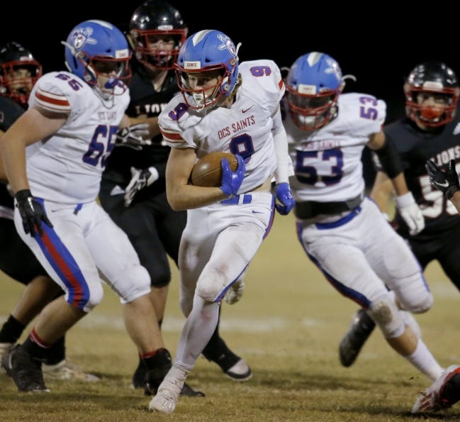 Oklahoma Christian School's Braden Roberts (9) carries the ball in a 23-15 win at Luther on Friday. [Sarah Phipps/The Oklahoman]