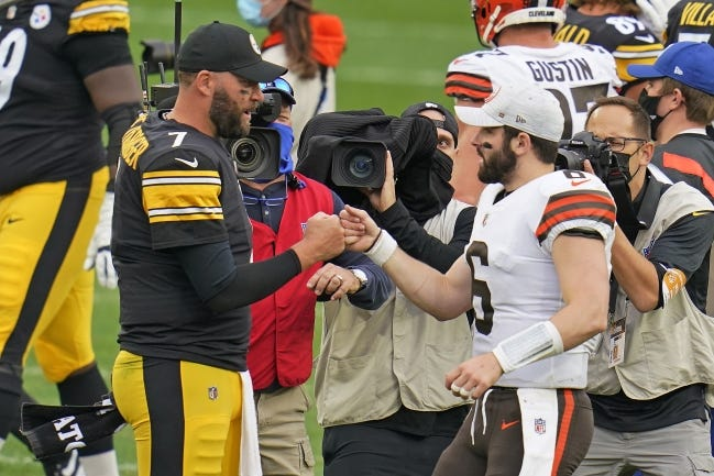 Pittsburgh Steelers quarterback Ben Roethlisberger (left) and Cleveland Browns quarterback Baker Mayfield bump fists Sunday after the Steelers rolled to a 38-7 win at Heinz Field. [AP Photo/Gene J. Puskar]