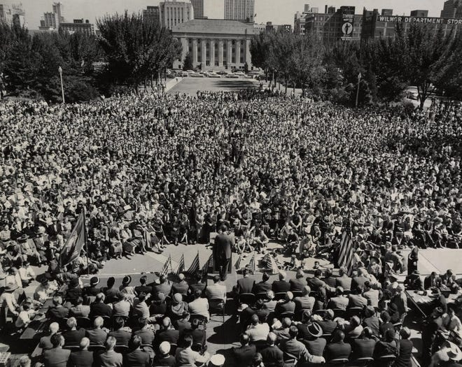 """Presidential candidate Adlai Stevenson addresses a crowd of thousands in front of the Civic Center in October 1952. Looking toward the November election, Stevenson promised """"peace and prosperity"""" with his campaign bid during his visit to Oklahoma. After two speeches and a parade, the former Illinois governor, as well as Oklahoma Gov. Johnston Murray, boarded an American Airlines plane labeled the """"Stevenson Special"""" and traveled to the next campaign stop in New Orleans. On election day, Stevenson's opponent, Dwight D. Eisenhower, won in a landslide victory, becoming the 34th U.S. president. [RONALD PYER/THE OKLAHOMAN ARCHIVES]"""