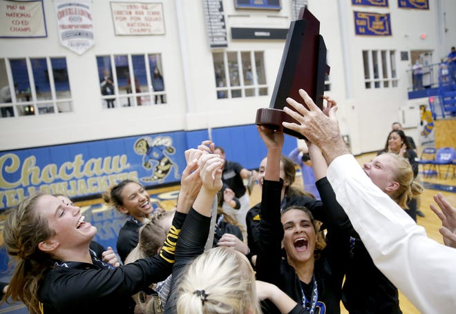 Victory Christian celebrates with the Class 5A volleyball state championship trophy after beating Mount St. Mary on Tuesday in Choctaw. [Sarah Phipps/The Oklahoman]