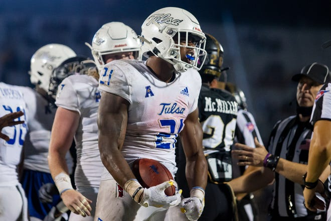 Tulsa running back T.K. Wilkerson (21) celebrates after scoring a touchdown during the third quarter of a 34-26 win at Central Florida on Oct. 3. [Mary Holt/USA TODAY Sports]