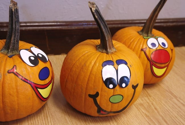 Small pumpkins decorated by children at a metro church's harvest festival are shown in this picture. Some churches are hosting drive-thru Halloween alternative events this year due to COVID-19. [Oklahoman Archives]