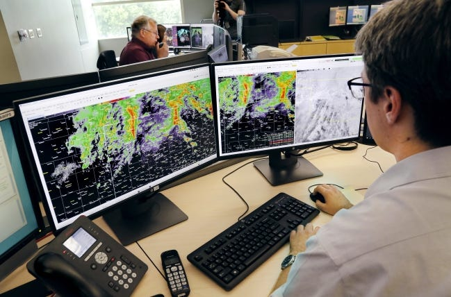 Meteorologist Alex Zwink sits at his desk studying weather models and storm patterns in a room filled with fellow meteorologists and researchers with the National Weather Service in 2019.  [THE OKLAHOMAN ARCHIVES]