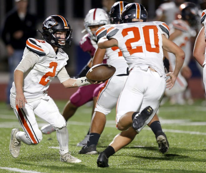 Crescent's Hunter Wilmoth runs the options during Thursday's football game between Crescent and Oklahoma Christian Academy at Edmond North High School. [Sarah Phipps/The Oklahoman]