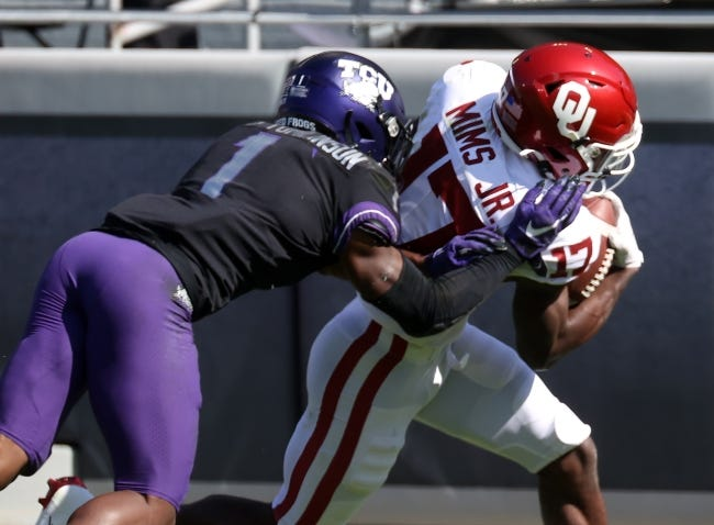 Oct 24, 2020; Fort Worth, Texas, USA; Oklahoma Sooners wide receiver Marvin Mims (17) scores a touchdown as TCU Horned Frogs cornerback Tre'Vius Hodges-Tomlinson (1) defends during the first half at Amon G. Carter Stadium. Mandatory Credit: Kevin Jairaj-USA TODAY Sports