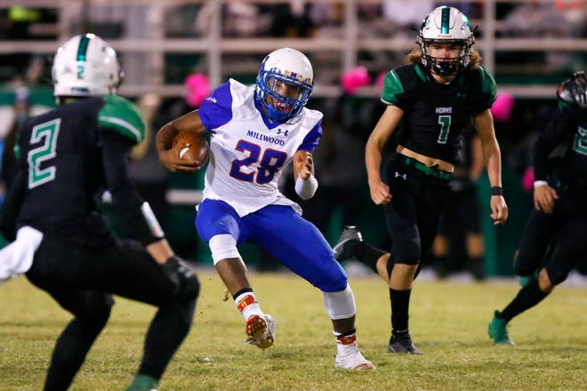 Millwood's Rickey Hunt Jr. carries the ball during a high school football game between Jones and Millwood in Jones, Okla., Friday, Oct. 23, 2020. [Bryan Terry/The Oklahoman]