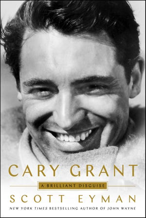 """This cover image released by Simon & Schuster shows """"Cary Grant: A Brilliant Disguise,"""" by Scott Eyman. (Simon & Schuster via AP)"""