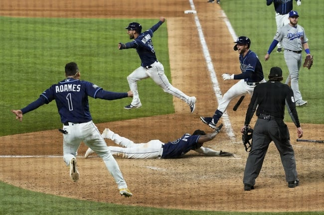 Tampa Bay's Randy Arozarena celebrates after scoring the winning run in Game 4 of the World Series on Saturday. The Rays beat the Dodgers 8-7. [AP Photo/Eric Gay]