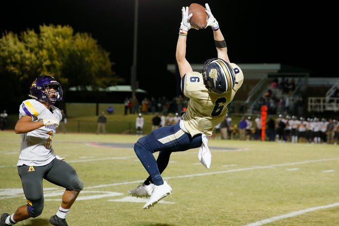 Heritage Hall's Gavin Freeman catches the ball in front of Anadarko's Lucas Camp during a high school football game between Heritage Hall and Anadarko at Heritage Hall in Oklahoma City Saturday, Oct. 24, 2020. [Bryan Terry/The Oklahoman]