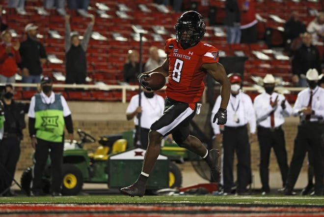 Texas Tech's Zech McPhearson scores a touchdown after a fumble recovery during the second half of Saturday night's game against West Virginia in Lubbock, Texas. [AP Photo/Brad Tollefson]