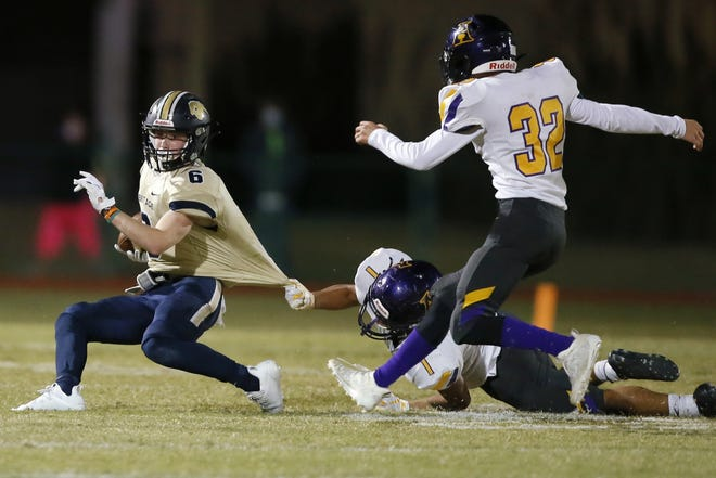 Heritage Hall's Gavin Freeman tries to get away from Anadarko's Lucas Camp, center, and Cade Lewis, right, during Saturday's game. [Bryan Terry/The Oklahoman]