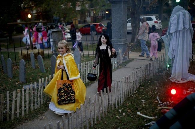 Children are shown trick-or-treating during a previous year's Halloween. This year could look a lot different, with health officials recommending trick-or-treaters, as well as homeowners, wear masks and take precautions to avoid COVID-19 transmission. [SARAH PHIPPS/THE OKLAHOMAN ARCHIVES]