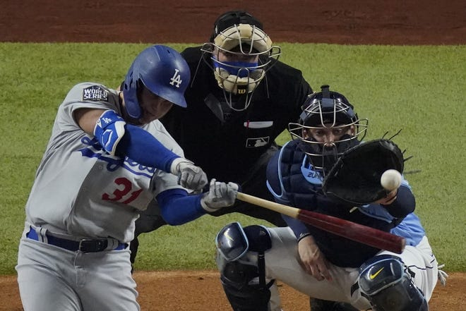 Dodgers' Joc Pederson hits a home run against the Tampa Bay Rays during the second inning in Game 5 of the World Series. [AP Photo/Sue Ogrocki]