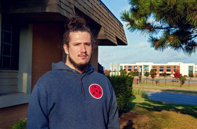 Oak Grove Apartments resident Jacob North stands outside his home, located across the street from Dell EMC. Despite living next to a high-tech office building a few miles from downtown Oklahoma City, North and other residents have struggled to get high-speed internet access. [CHRIS LANDSBERGER/THE OKLAHOMAN]
