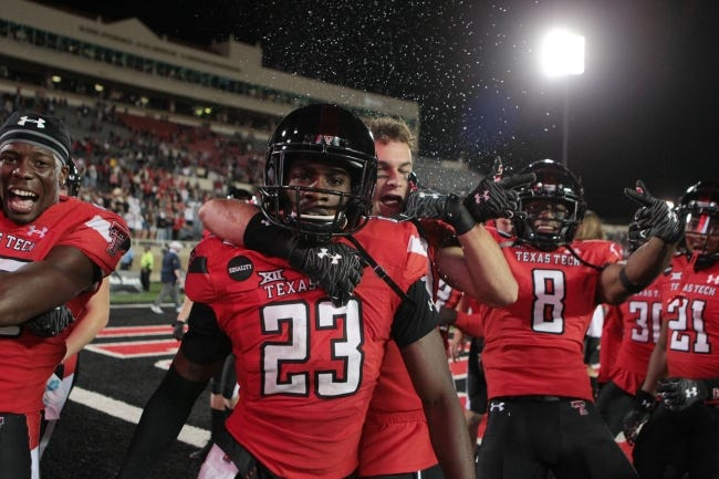 Texas Tech defensive back DeMarcus Fields (23) celebrates with his teammates after the Red Raiders' 34-27 win over West Virginia last Saturday. [Michael C. Johnson-USA TODAY Sports]
