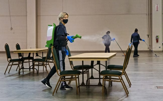 Crews on Wednesday work to sanitize a warming center at the Cox Convention Center set up by the city of Oklahoma City and the American Red Cross. The center was opened for one day, but officials will evaluate the need for a warming center beyond Wednesday if necessary. The center is not open as an overnight shelter. [Chris Landsberger/The Oklahoman]