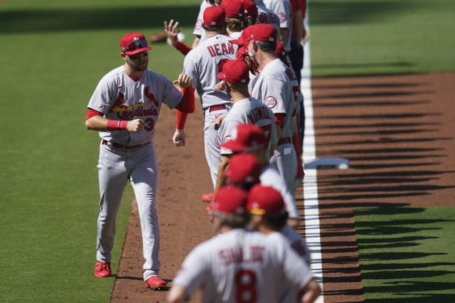 St. Louis Cardinals right fielder Dylan Carlson greets teammates before Game 1 of a National League wild-card series against the San Diego Padres on Sept. 30. [AP Photo/Gregory Bull]